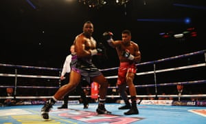 Anthony Joshua gets on top against Dillian Whyte as the fight progresses.