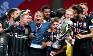 Northampton Town manager Keith Curle celebrates with the players.
