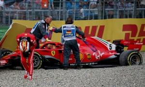 Sebastian Vettel looks dismayed after sliding out