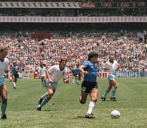 Maradona runs past English defenders Terry Butcher (left) and Terry Fenwick (second left) on his way to scoring his second goal during the World Cup quarter-final between Argentina and England in June 1986