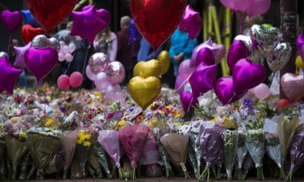 Balloons and flowers in St Ann's Square in Manchester.