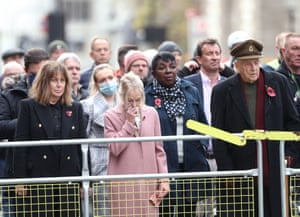 Members of the public fall silent at the Cenotaph
