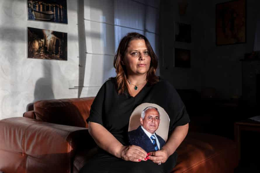 Angelina Landa with a photo of her father, Michele Landa, killed by the Camorra in 2006.
