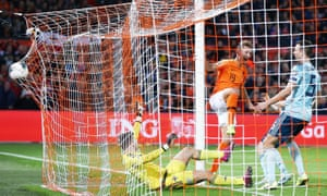Luuk de Jong of Netherlands scores his sides second goal.