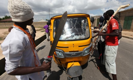 Vigilantes of the Civilian Joint Task Force form a checkpoint on the street in Maiduguri, Nigeria.