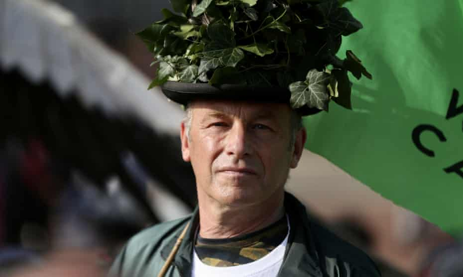 Packham campaigning in London wearing hat covered in ivy.