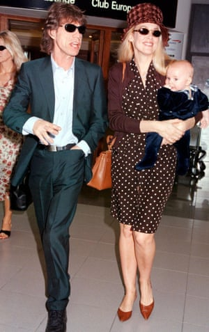 Mick Jagger and Jerry Hall with their son Gabriel at Heathrow airport in 1998.