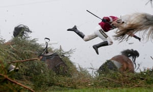 Nina Carberry flies off Sir Des Champs as they fall at the Chair fence during the Grand National at Aintree, Liverpool
