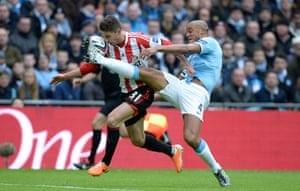 2 March 2014: Fabio Borini rides a challenge from Vincent Kompany before scoring for Sunderland against City in the League Cup final.