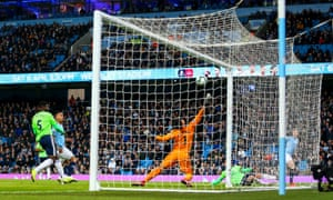 Kevin De Bruyne drives Manchester City into the lead against Cardiff from an acute angle on his second game back after injury.