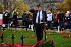 Members of the public observe the two-minute silence in the Garden of Remembrance in Princess Street Gardens in Edinburgh