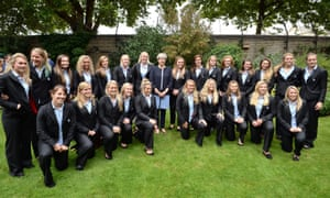 Theresa May posing with members of England women's rugby team during a reception at 10 Downing Street.
