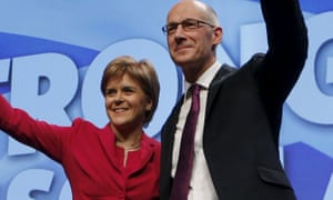 John Swinney  and  Nicola Sturgeon greet supporters at the SNP conference