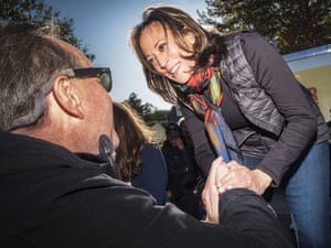 Kamala Harris talks to individual voters after a block party in Des Moines in October.
