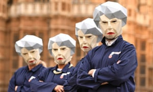 Members of the GMB union dressed as 'Maybots' demonstrating at Westminster, London in November 2017.