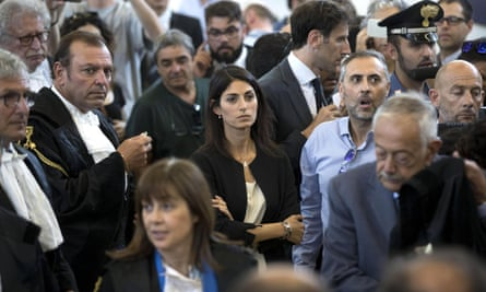 Rome's mayor, Virginia Raggi, centre, watches in the courtroom at Rebibbia prison.