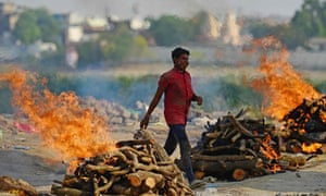 Funeral pyres burn as the last rites are performed of the patients who died of the Covid-19 coronavirus at a cremation ground in Allahabad on April 27, 2021.