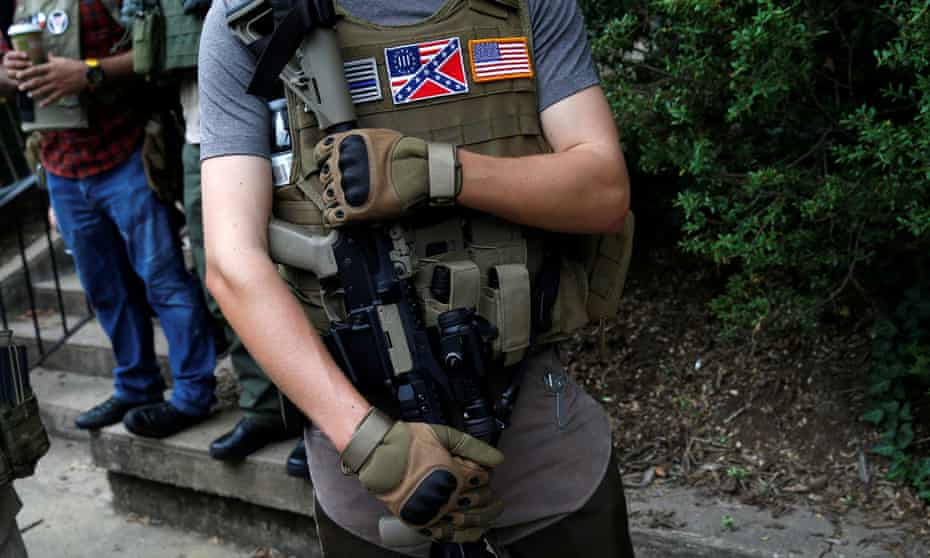 A member of a white supremacists militia stands near a rally in Charlottesville, Virginia in August 2017.
