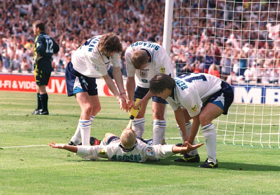 Paul Gascoigne and teammates celebrate scoring against Scotland, mimicking his notorious 'dentist's chair' drinking session