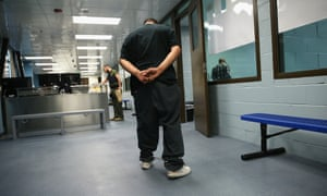 An immigrant walks in chains through a US Immigration and Customs Enforcement (ICE), processing center in Camarillo, California.