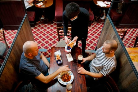 Customers at a JD Wetherspoon pub in Stratford, east London.