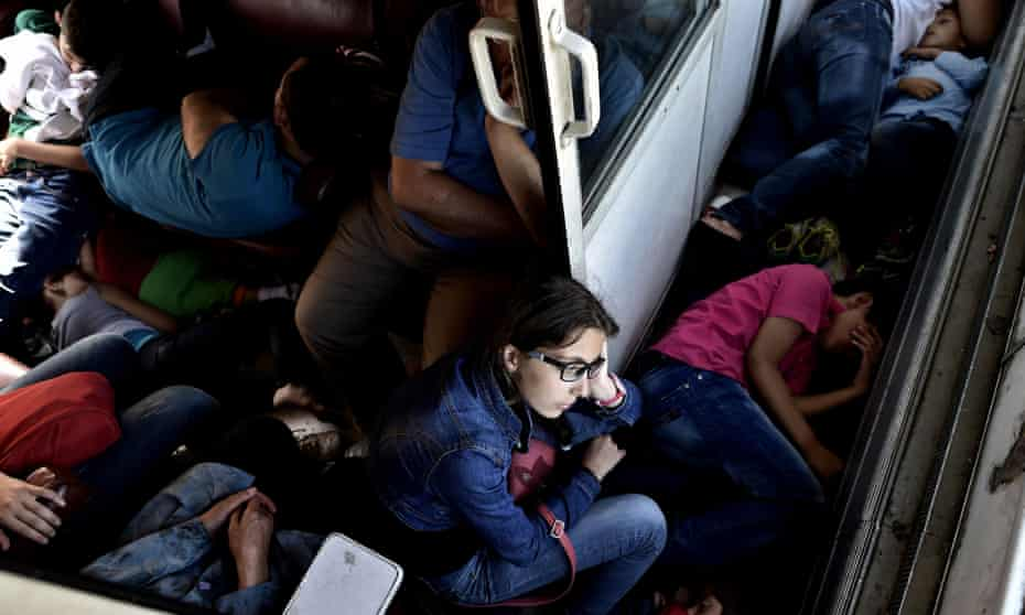 Syrians travel on a train taking them from Macedonia to the Serbian border on 30 August 2015.