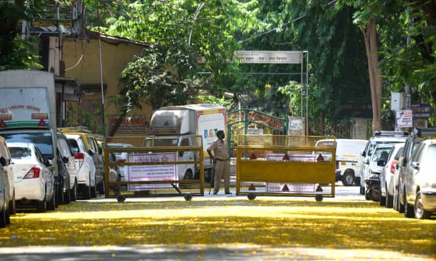 Mumbai police guard the Sion hospital during the ongoing national lockdown