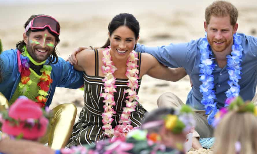 Prince Harry and Meghan join the surfing community group OneWave's 'Fluro Friday' gathering at Bondi beach on Friday