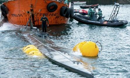 Spanish Guardia Civil refloating the submarine.
