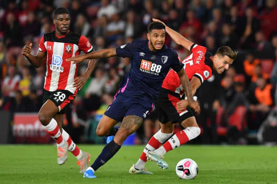 Joshua King escapes the attention of two defenders during Bournemouth's win at Southampton.