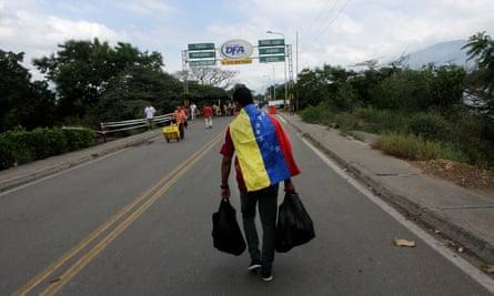 A man crosses the Francisco de Paula Santander international bridge, linking Urena, in Venezuela and Cucuta, in Colombia.