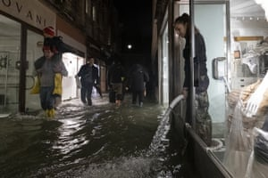 A pump discharges floodwater from a shop
