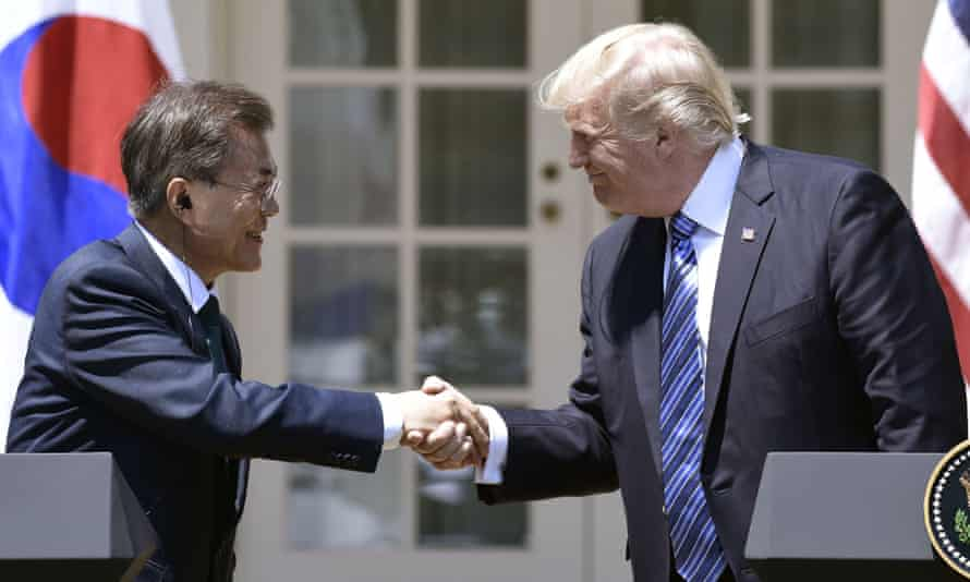 Donald Trump shakes hands with South Korea's president, Moon Jae-in, in August.