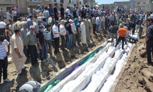 A mass burial on 26 May 2012 in Houla.