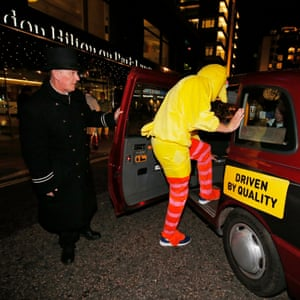 """6ft 10"""" Dominic Bird has chosen an apt outfit as he attempts to crams himself into a black cab as the team head off to celebrate Halloween."""
