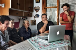 Derki (right) shows the film to Konstantina Mpalli, Aimilia Kamvisi, Maristsa Mavrapidou and Kostas Pinteris (left to right) in Mavrapidou's home in Skala Sykamineas on the island of Lesbos. In 2015, when thousands of refugees arrived on the shores around Skala Sykamineas, many villagers provided food and, like Pinteris, rescued them from unseaworthy boats.