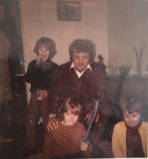 Mark, centre, with his father, brother Tony and sister Karen (front right).