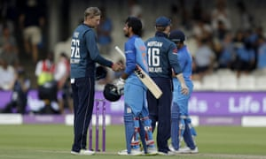 India's Yuzvendra Chahal, second left, shakes hands with England's Joe Root at the end of the one day international.