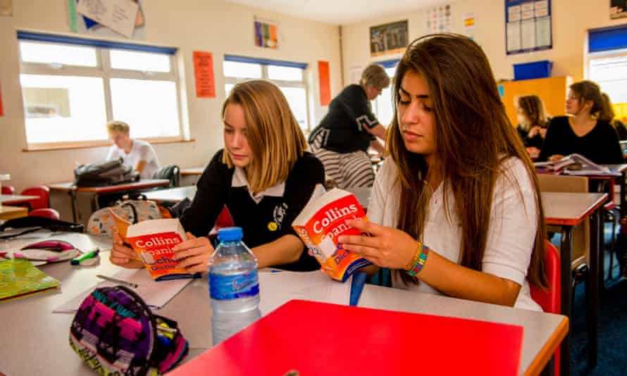 Teenagers study A-level Spanish in a classroom.