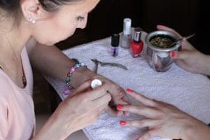 A women gets a manicure in Lorena's salon.
