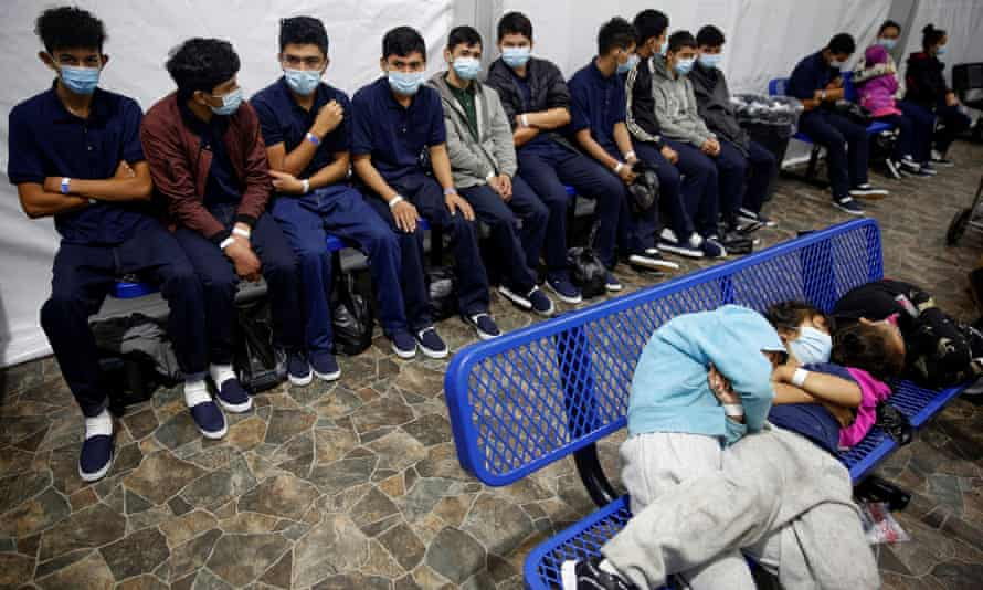 Young unaccompanied migrants wait their turn at a processing station inside the CBP facility in Donna, Texas, on 30 March.
