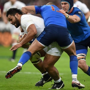 Billy Vunipola barges through France's Bernard Le Roux and Gael Fickou.