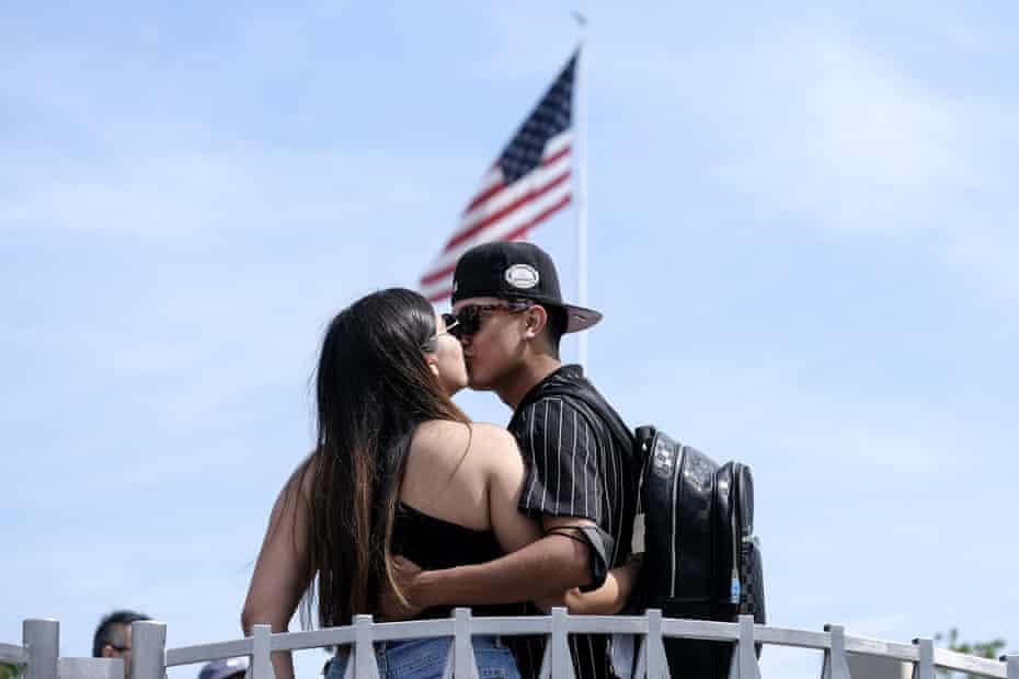 Silvia Guillen, 19, and her boyfriend Joseph Alvarez, 22, share a kiss at Universal Studios in Universal City, California.