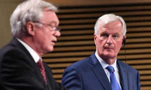 Brexit secretary David Davis (L) and EU chief negotiator Michel Barnier address the media after the third round of talks.