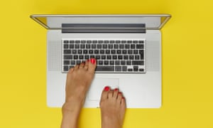 Photograph of feet on laptop