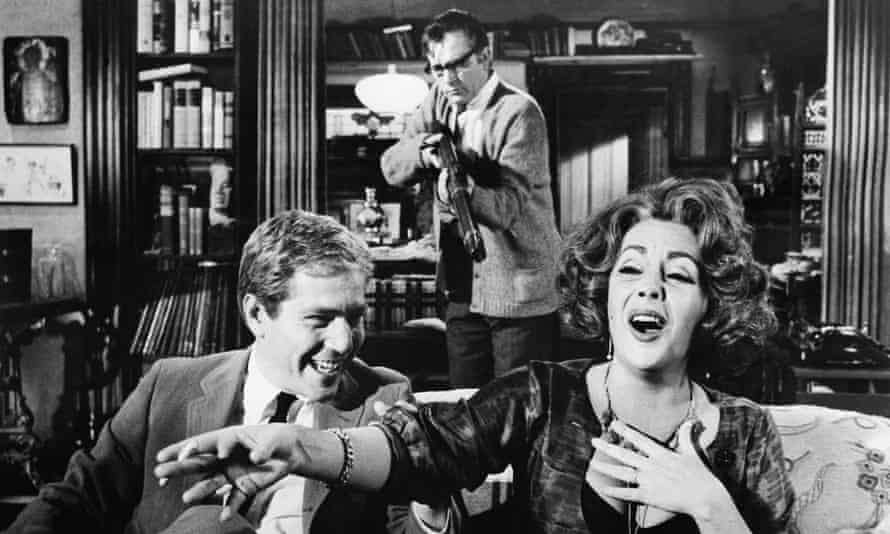 George Segal, Richard Burton (holding the rifle) and Elizabeth Taylor in the film of Who's Afraid of Virginia Woolf?