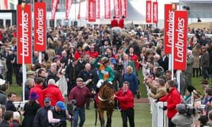 Gavin Sheehan celebrates on Cole Harden after winning the Ladbrokes World Hurdle at the Cheltenham Festival in 2015.