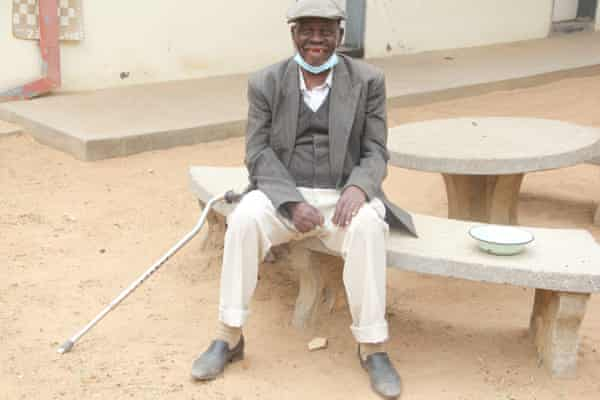 Domingo Zakani sits in a courtyard at Soda in Harare. He has lived in the home for five years.