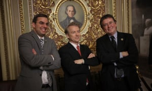 Senator Rand Paul, centre, takes a brief break from the floor of the US Senate to pose for a photo