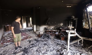 A picture shows the damage inside the burnt US consulate building in Benghazi on 13 September 2012, following an attack on the building.